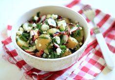 spring salad with baby potatoes, spring onion, bacon and loads of fresh herbs.
