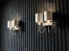 Silhouette | A modular lamp with a plate glass structure. Diffusers in fabric with a variety of finishes Power cables faced with cotton.