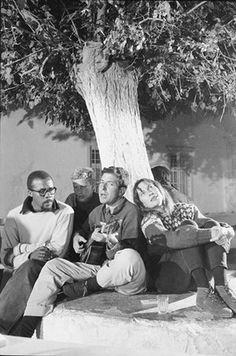 Hydra, Greece October 1960 Leonard Cohen playing guitar next to partner Marianne Ihlen.
