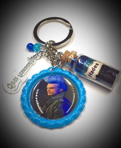 descendants 3 Keychain includes 1 1 bottle cap 1 bead charm blue and dark blue 1 silver guitar charm 1 glitter bottle that says Hades DISCLAIMER I do not claim any ownership over the ch The Descendants, Disney Descendants Dolls, Descendants Characters, Hades, Dove Cameron, Disney Villains, Disney Movies, Audrey Doll, Dreamworks