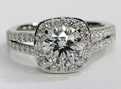 Eyes will be fixated on this immaculate platinum engagement ring, showcasing a halo design and 48 pavé-set round diamonds.