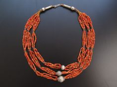 Stunning Ancient Yemeni Coral and Silver Beaded Necklace. Jewellery Caravan specialised in designing, manufacturing, wholesaling bulk Islamic arts, Ancient arts, Vantage silver, antique jewellery, ethnic jewellery, tribal jewellery, tribal rugs, tribal kilim, Architectural, Antique wood works, Bronze, Ancient beads, old beads, glass beads, lapis lazuli beads, silver beads, and gold beads.