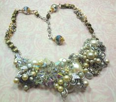 Glitz collage made by Brenda Sue Lansdowne of B'sue Boutiques, of repurposed crystal, a few stray earrings and buttons, and silverware silverplated findings.   One of a kind.