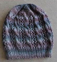 This light and airy hat matches the Sausalito Smoky Cables-and-Lace Cowl and Smoky Cables-and-Lace Fingerless Gloves. Knitted at a slightly looser gauge than is typical for a fingering-weight yarn, Sausalito is an excellent choice for this soft and cozy set.
