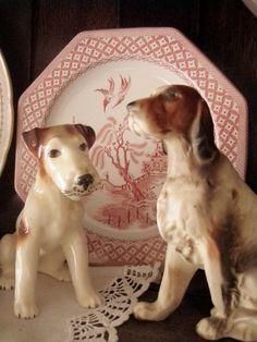 Closeup of dog figurines and transferware