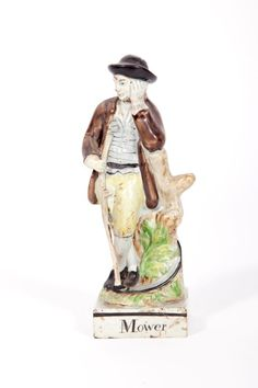 A RARE EARLY 19TH CENTURY STAFFORDSHIRE PEARLWARE FIGURE,  entitled The Mower,  modelled as a man standing by a tree stump holding a scythe, 7.5'' (19cm). (1)