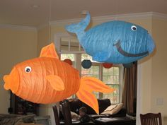 Turquoise cocoon paper lantern for the whale and mango for the goldfish ... great kids' party idea! Shop colors online at http://www.partylights.com/Lanterns/Cocoon.