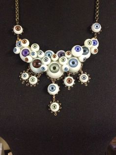 "FUF March 6th my ""eye be watching you"" necklace made out of old dolls eyes"