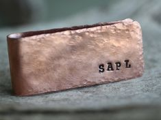 The Rustic Copper Mens Money Clip is handmade by me in my home workshop. Each money clip begins as a sheet of copper that is sawed, filed, and sanded to size. Then it is hand hammered to give it a rustic finish. Next, I hand stamp your initials into the side of the money clip. It is then formed into the correct shape. Lastly, it is oxidized and given a brushed finish. - Dimensions: 1 inch wide x 2 1/2 inches long  Please note - This item will oxidize and naturally develop a patina over time…