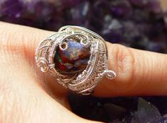 Black Opal wrapped in Sterling Silver