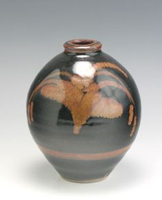 David Leach 1911- 2005  Bottle Vase, Lowerdown Pottery, Bovey Tracey Devon, 1976  Light grey stoneware body, tenmoku glaze with illmenite decoration, in this case David's most well known pattern, the so named Foxglove.  Impressed DL, David Leach's personal mark.  H. 16.3cm