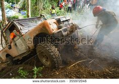 Kiulu Sabah Malaysia - Dec 20, 2015:Extreme 4X4 car passing a muddy trail of jungle route in the rainforest of Sabah Malaysian Borneo.Sabah jungle is popular for 4X4 adventures.