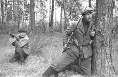 Byelorussian guerillas posing in a forest circa 1943. Note PPD-40 submachine gun Mosin-Nagant M1891 rifle.