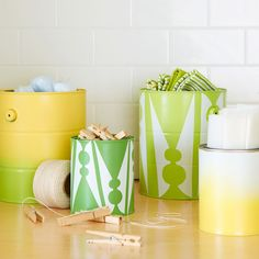 Freshen and straighten up your laundry supplies with DIY stenciled containers.