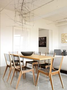 modern dining room by Croma Design Inc