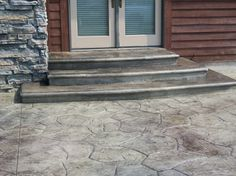 Stamped concrete patio with steps  --  random stone pattern