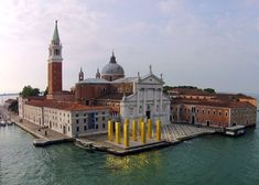 The Sky over Nine Columns by Heinz Mack. Towering golden columns on the Venetian island of San Giorgio Maggiore.