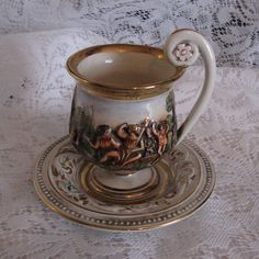 Unique R. Capodimonte,Made in Italy 1535/336 ,Gold trimmed, Embossed Cherubs, footed cup Teacup and Saucer,