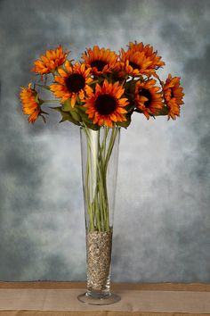 Bring crisp autumnal warmth to your arrangements with this Sunflower Spray. This orange sunflower will bring festive color to your fall decor and is excellent for using in a harvest themed centerpiece. The flower heads can also be used individually to
