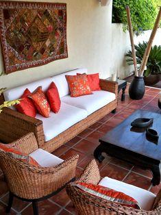 patio-decoration-ideas-bamboo-poles-sofa-terracotta-tiles