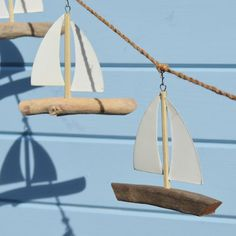 Pretty nautical garland with six driftwood sail boats strung together with a natural twine rope.