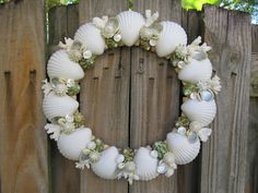 Beach Decor Seashell Wreath with White, Green and Pearled Shells and White Coral. $105.00, via Etsy.