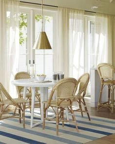 313 best Coastal Dining Rooms images on Pinterest in 2018   Coastal     A polished brass light pendant has a striking presence in this chic dining  room with Parisian