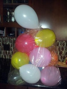 Instead of cash in a boring card I filled balloons with $$ and a few with confetti, wrapped in a gift basket bag and ta- da a birthday gift for that teen that just wants cash