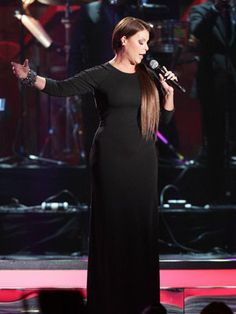 """Olga Tañón - The 45-year-old singer is a pro at getting the party started! Olga is known to her fans as """"The Woman on Fire,"""" a name that was given way before Alicia Keys came up with the song title. The Puerto Rican singer known for hits like, """"Una Nueva Mujer"""" and """"Asi Es La Vida,"""" has earned two Grammy Awards and three Latin Grammy Awards in the span of her career."""