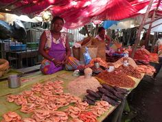 Ladies selling dry seafood on a market in Tamatave MADAGASCAR