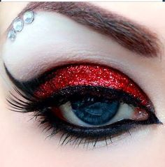 Dramatic. Red eyemakeup. Costume