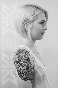 Complex geometric tattoo design on the shoulder by Roxx TwoSpirit