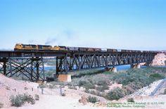 https://flic.kr/p/JKkj3Y   ATSF 8138 w, Needles, CA. 4-25-1982   AT&SF, Santa Fe GE C30-7, #8138 leads a westbound grain train on the massive trestle across the Colorado River at Park Moabi, Needles, CA. 4/25/1982