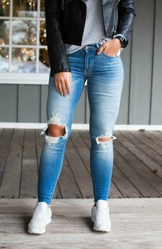 All you need to complete your outfit are these My One True Love Distressed Skinnies! We're obsessed with the double knee distressing this season!