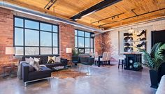 Loft near downtown Toronto; exposed brick huge windows 10.5 ft high ceilings. [2000x1150] http://ift.tt/2jAUOB2