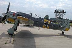 The Focke-Wulf Fw 190 Würger (Shrike) was a German Second World War single-seat, single-engine fighter aircraft designed by Kurt Tank in the late 1930s. Powered by a radial engine, the 190 had ample power and was able to lift larger loads than its well-known counterpart, the Messerschmitt Bf 109. The 190 was used by the Luftwaffe in a wide variety of roles, including day fighter, fighter-bomber, ground-attack aircraft and, to a lesser degree, night fighter.