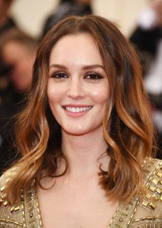 Leighton Meester's soft curls + natural makeup: http://www.stylemepretty.com/2015/11/04/celebrity-hair-makeup-looks-to-steal-for-your-wedding/ | Photography: Getty Images - http://www.gettyimages.com/