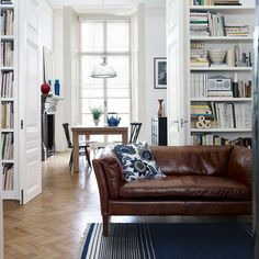 Floor to ceiling bookshelves are a great use of space.
