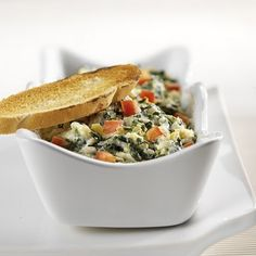Hot artichoke and Spinach dip with Garlic Croutons. This one always scores me rave reviews!