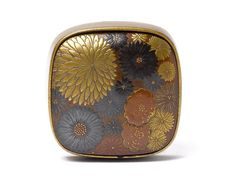 A lacquer hako-netsuke By Ikeda Taishin, 19th century Of rounded square form, the base of fundame-nuri and the cover lacquered with a mass of kiku blooms in gold and coloured takamakie, the interior of light brown lacquer, signed Taishin.