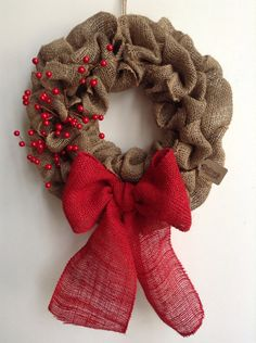 Burlap Christmas Wreath. Love the red bow and berries.