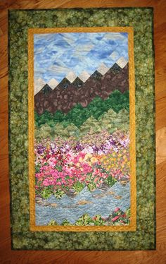 Wall Hanging Quilts rocks and ice mountain lake scene with trees green, blue, and grey