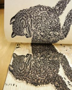 """Mirror image: """"THE WOLF"""" woodcut looks at """"THE WOLF"""" woodblock - on press earlier this year #tbt; limited edition of hand-pulled prints available in the T.B.P.S. shop & Etsy #woodcut #woodcarving #printing #tugboatprintshop #valerielueth #thewolf #wolfprint #printmaking #woodcutprocess"""