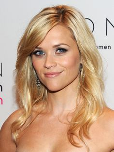 Reese Witherspoon with a deep side part loose waves hairstyle, pink blush and a subtle smoky eye