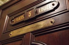 "Box 5 at the Paris Opera House.  ""Louee"" means the box has been taken (by The Phantom!)"
