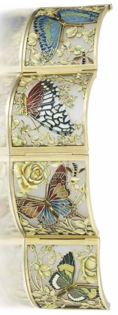 A RARE ART NOUVEAU ENAMEL BRACELET, BY CARRERAS, CIRCA 1905. Composed of four curved panels, each with a vari-coloured cloissoné enamel butterfly centre, within an openwork surround of realistically modelled flowering boughs, to a frosted glass ground and polished frame, 19.0cm, in original Carreras fitted leather case. #Carreras #ArtNouveau #bracelet