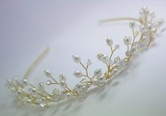 want to make one like this, but with silver wire, not gold and I'd use more Swarovski AB crystals