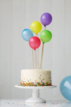 Birthday cake with colorful balloons by Ruth Black for Stocksy United - .- Geburtstagstorte mit bunten Luftballons von Ruth Black für Stocksy United – Birthday cake with colorful balloons by Ruth Black … - First Birthday Cakes, Birthday Parties, Free Birthday, Colorful Birthday Cake, Simple Birthday Cakes, Diy Birthday Cake, Easy Kids Birthday Cakes, Birthday Cake Toppers, Simple Birthday Cake Designs