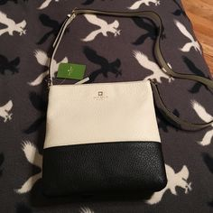 NWT, Kate Spade Cora Black & Off White Cross Body Brand new with tags, never used. Authentic, southport avenue bag, is 10x10, roomy and cute. black and off white kate spade Bags Crossbody Bags