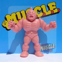 """M.U.S.C.L.E. Figures... This guy was my favorite. Well, him and the little """"Amazon"""" figure who sort of had a piraña head."""
